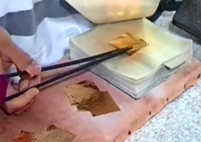 Gold leaf being transferred for further beating